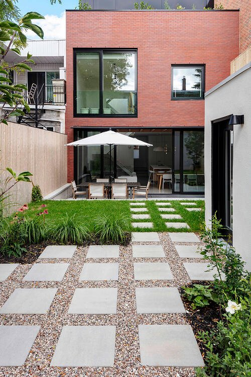 Concrete stone walkway in a small backyard featuring our Industria 600.