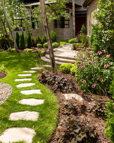 Backyard garden path leading to the patio designed with our Maya concrete stones.